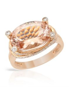 Cocktail ring with genuine diamonds and morganite in rose gold.