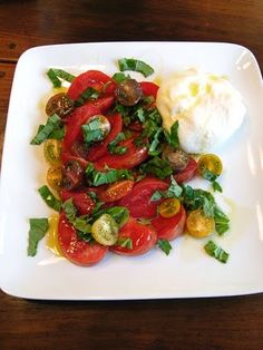 Tomatoes and Basil with Fresh Burrata Cheese, Sea Salt, Fresh Ground Pepper and Extra Virgin Olive Oil... mmmm