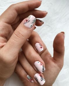 Pretty nude pink floral nails.