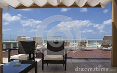 Roof In Front Of The Sea With Tanned Beds, Armchais, Blue Sky And White Clouds - Download From Over 63 Million High Quality Stock Photos, Images, Vectors. Sign up for FREE today. Image: 97672943