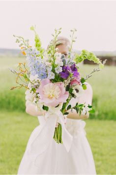 vibrant and whimsical wildflower bouquet. see more gorgeous images from Ashleigh Hobson here http://www.weddingchicks.com/vendor-guide/ashleigh-hobson-photography/