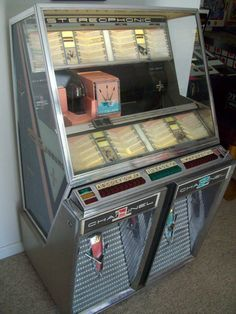 Different views of this Seeburg 222 jukebox coming up.  We bought one in 1990 when our kids were about 8 and 11.  It really got them interested in old 1960's music and they continued to learn about music and still are doing so to this day.  kp
