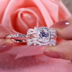 It Showcases A Sparkling Round Cut Center Stone Wrapped in A Halo Frame,Bringing out Its Beauty And Sparkle. The Inner Band of Rose Gold Color Is Brightened by A Row of Shimmering Round Stones, Adding A Pop of Color to The Choice. Ring Set, Ring Verlobung, Solitaire Ring, Jewelry Rings, Fine Jewelry, Jewelry Box, Jewelry Armoire, Jewelry Clasps, Jewelry Dish