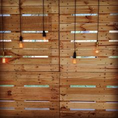 Pallet backdrop with hanging retro lamps for hire in Suffolk wedding lighting hire