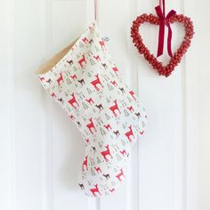 Fill their stocking, with a stocking! Large Ivory Reindeer Linen Stocking by Charlotte Macey