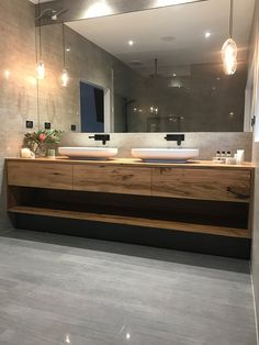 This gorgeous custom floating timber vanity made from solid recycled Messmate timber feautres Omvivo's Venice 700 basins. The organic design of the solid surface basins work beautifully with the recycled markings and grain patterns of the timber. The pendant lights are a lovely finishing touch.