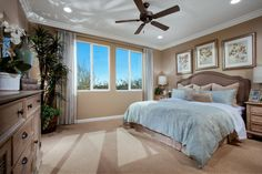 The owners suite of the Soho floorplan is what dreams are made of.  This room is decorated in comforting colors that will ensure a good night sleep.  You can also see a beautiful view out of the large window.  Pictured:  Soho floorplan, The Heights at Loma Vista