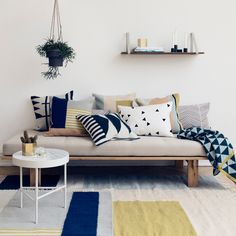 """Ferm Living's Kelim pillows each feature a geometric, graphic pattern perfect for mixing and matching. 20"""" x 20"""". Two different styles: Black Line or Black Triangles. Please note than Kelim pillows ha"""