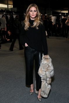 Olivia Palermo | black sweater oversized + black leather culottes + Pointed toe snakeskin heels + fuzzy fur white brown oversized coat