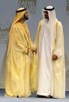 Dubai's ruler, Sheikh Mohammad bin Rashed al-Maktoum, who is also vice president and prime minister of the UAE speaks to Sheikh Mohammed bin Zayed al-Nahyan (R), Crown Prince of Abu Dhabi and the UAE's deputy commander-in-chief of the armed forces, during the opening of the World Future Energy Summit in the Emirati capital Abu Dhabi on 19.01.2015.