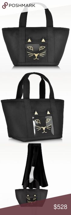 CHARLOTTE OLYMPIA Feline Ami Kitty Canvas Tote Bag Feline Ami Kitty Black Canvas Tote Bag crafted in cotton canvas is a super chic and extra spacious tote and makes the perfect grab-and-go bag for your everyday essentials. Featuring open compartment closure, double handles, internal open pocket and external translucent open pocket with cat face design. Genuine Charlotte Olympia.Width	13.39"