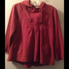 Hooded peacoat sweatshirt Is red hoodie is adorable. 3/4 sleeves and heavier to keep you warm, with a hood. Big chunky buttons in a peacoat type style and a slightly skirted bottom that goes below the hips but not super long. Never worn, size small, will also fit XS too. Mossimo Supply Co Tops Sweatshirts & Hoodies