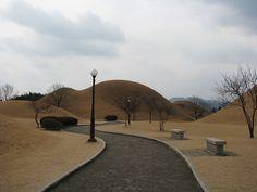 대릉원 or Tumuli Park, a park with many large excavated burial mounds, including Cheonmachong, a mound that had been hollowed out and set up like a museum so you can see what was actually inside these large grass hills