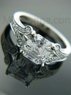 Gorgeous Asscher-cut stone in a beautiful vintage setting.  For my next wedding ring? (HAHAHAHA)