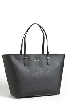 - Crosshatched leather composes a minimalist tote with vintage glamour. - Top zip closure. - Top carrying handles. - Interior zip and wall pockets. - Logo-jacquard lining. - Protective metal feet. - L
