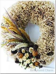 This Crafty Coffee Filter Wreath is just what you need to put the spirit of fall right on your front door. Follow along with this tutorial to learn how to make a paper wreath using some coffee filters. This project is so easy to create.