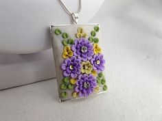 Colourful Rectangle Pendant with clay floral by TunicBotik