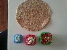 Mediterranean wrap...hummus, feta, chicken, and cucumber/tomato salad