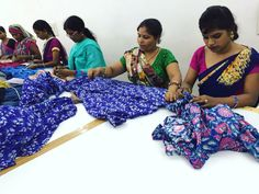 Employees working on AW16 hand block printed dresses.