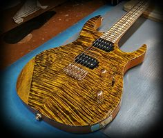 DC600 in this incredible special custom finish done by Jeff Kiesel over flamed maple top and white limba body, Zebrawood fretbaord and Kiesel Pick ups!