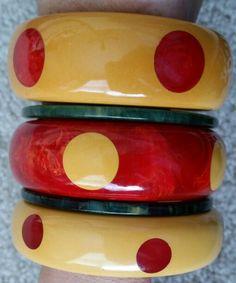 Red and ivory vintage bakelite dot bracelets.