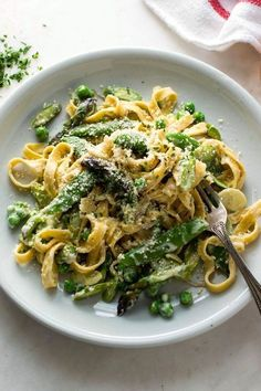 simple pasta primavera with asparagus, peas and spring onions
