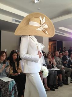 gorgeous pantsuit and floppy hat at Carolina Herrera