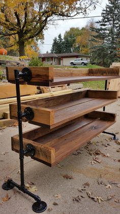 In the picture is a reclaimed black Walnut shoe rack. All my furniture is made to order. You can choose the number of shelves, H,LW. And also the color