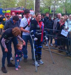 A ReWalk robotic exoskeleton allows a paraplegic woman to start and finish the London Marathon, covering the 26.2-mile course over 17 days.