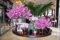 "At the third annual ""Most Wanted"" fashion event in Toronto in 2009, varying silver and glass vessels filled with purple flowers—inspired by the Four Seasons Hotel George V Paris' famous lobby floral displays—topped a table in the reception area."