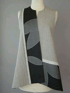 Long Round Neck Vest with Abstract Shapes and Teal Accent -- I don't see teal, but that'd be good -- add standing collar. Blouse Batik, Batik Dress, Batik Fashion, Creation Couture, Mode Inspiration, All About Fashion, Sewing Clothes, Refashion, Clothing Patterns