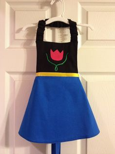 ANNA (FROZEN) APRON This adorable Disney inspired Anna apron will definitely draw out a little girls imagination. Whether shes pretending to be a princess or trying to be mothers little helper, shes sure to have hours of fun dressing up. Easy on/off with elastic neck strap and back ribbon ties. All fabrics are prewashed before the item is made to reduce shrinking. Care: Machine washable and line dry SIZING: There are three size options. Small 4/5 is sized for toddlers and younger ...