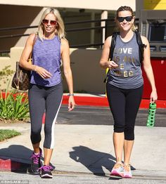 Stylish:The petite blonde stepped out in a grey sports tee that read Love is all you need as she teamed it with a pair of black capri leggings