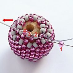 BEADED ball instructions - The written instructions are all in Russian, I think. But there are plenty of photos which are very clear and easy to follow. It would be very easy to make this beaded bead just from the photos. And you could use one of those translating sites to translate the instructions if you wanted.