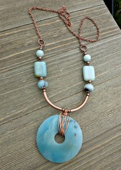 "The necklace is available in your choice of length. With copper tubing, copper chain and clasp. Amazonite beads. Amazonite: ""Stone of Hope"" As with all of my jewelry this is lead and nickel free. All"