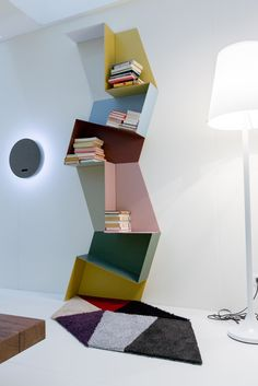 Colourful trapezoids, unespected combinations | Slide Shelf | #bookshelf #interior #lagodesign  #libreria