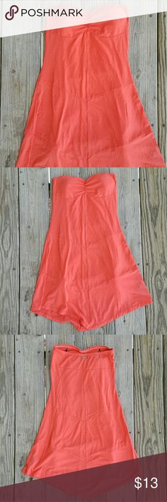 Guess Tangerine XS Asymmetrical Strapless Dress Guess Tangerine XS Asymmetrical Strapless Dress. Beautiful light airy flowy tangerine summer strapless dress. Pair it with heels or flats, shoulder bag shaw or half jean jacket a little jewelry or none at all. Gently worn. Guess Dresses Asymmetrical