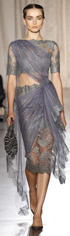 Marchesa. With a little less skin showing, this would be perfect.
