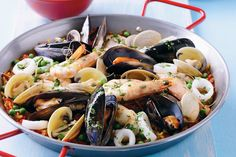 Paella originated in Valencia , Spain as a one-pan peasant dish made with a little bit of everything that was on hand. Fresh seafood, saffron and earthy paprika are the key ingredients in this traditional Spanish dish.