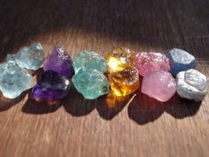 12 Rough Raw Gemstones Lot- 40 Ct Mix Raw Gems - Aquamarines - Ruby - Citrines - Apatites - Sapphires - Amethyst Lot MG793 by magicgemsbox on Etsy https://www.etsy.com/listing/265685776/12-rough-raw-gemstones-lot-40-ct-mix-raw