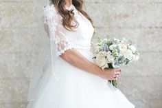 Gorgeous lace Hayley Page gown with overlay and neutral florals. | Oyster Bay Yacht Club Weddings | Alex Michele Photography, Jacksonville