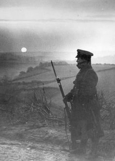 A British sentry cuts a lonely picture as he stands at his post at sunrise in France, March 1915