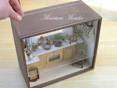 Miniature dollhouse fully equipped kitchen. Huge number of free removable accessories according photo included. Front sliding dust cover and the window