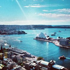 Sydney Harbour, Sydney, New South Wales, Australia. The white building in the centre is the Sydney Opera House. Outside of the picture frame to the left would be the the Sydney Harbour Bridge. https://www.google.ca/maps/place/Sydney+Opera+House/@-33.8558756,151.2078267,16z/data=!3m1!5s0x6b12ae668bf0cf55:0x1f2272a6333877ed!4m5!3m4!1s0x6b12ae665e892fdd:0x3133f8d75a1ac251!8m2!3d-33.8567844!4d151.2152967
