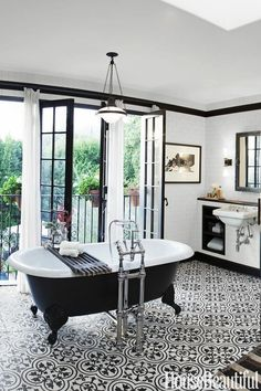Black and White Bathroom with Patterned Graphic Tile Floor - Like the white walls with black trim also.  Very classy