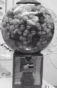 Creepy Gumball Machine full of Barbie heads.