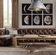 love the elements- moon photo sequence, industrial nasa looking overhead lighting, chesterfield and parsons table...just needs some color