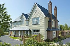 The colonial-style houses at St Irvyne's, in West Sussex, avoid the cookie-cutter feel with New England-style clapboard exteriors