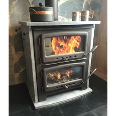 http://www.woodlanddirect.com/Wood-Stove-and-Accessories/Cook-Stoves/Vermont-Bun-Baker-XL-950-Wood-Cook-Stove