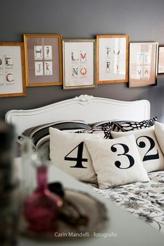 love the flash cards above the bed  desire to inspire - desiretoinspire.net - Reader's home - Carolina's typography-loving apartment
